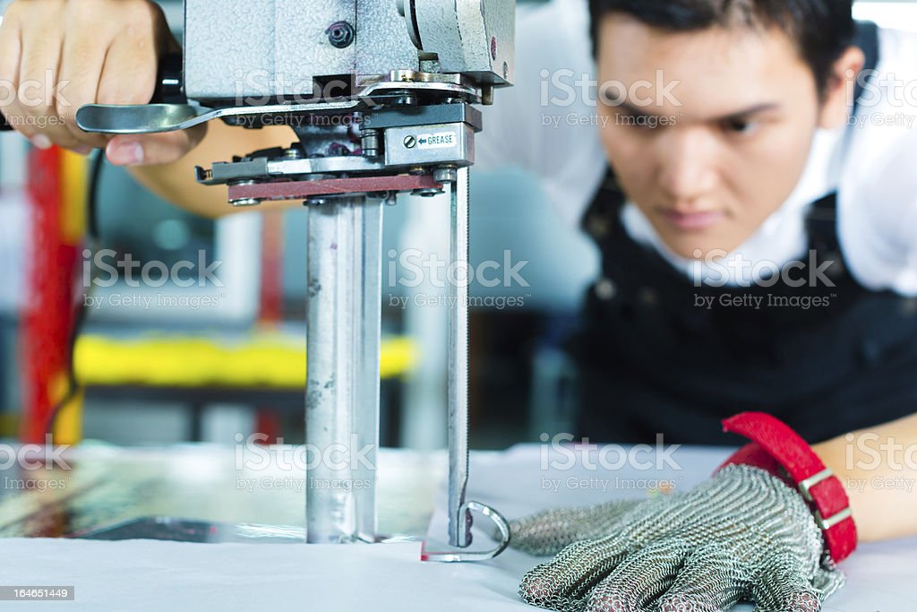 Worker using machinery in a factory stock photo