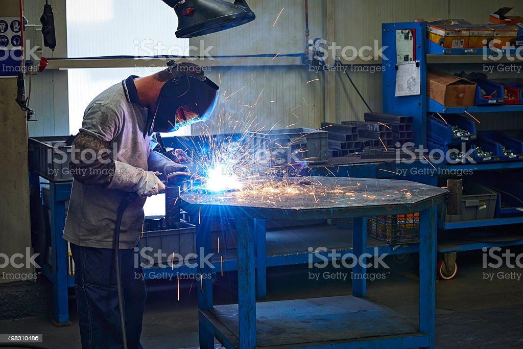 Worker with welder.