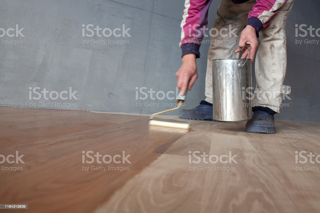 Worker Varnishing Lacquering A Parquet Stock Photo Download