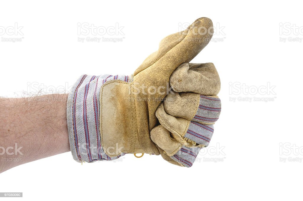 Worker wearing a glove and giving the thumbs up sign stock photo