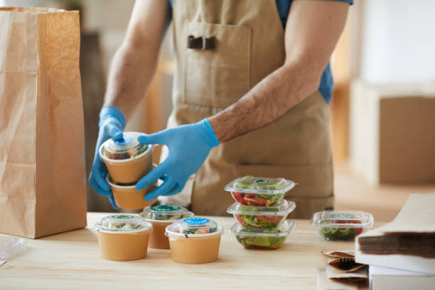 Worker Wearing Gloves at Food Delivery Service stock photo