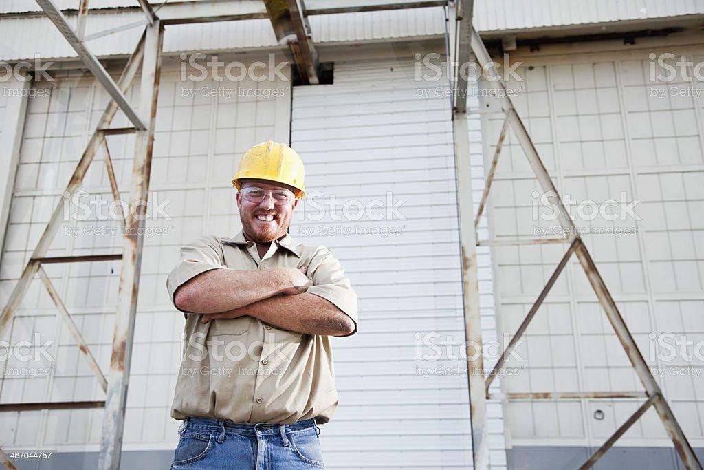 Worker wearing hardhat stock photo
