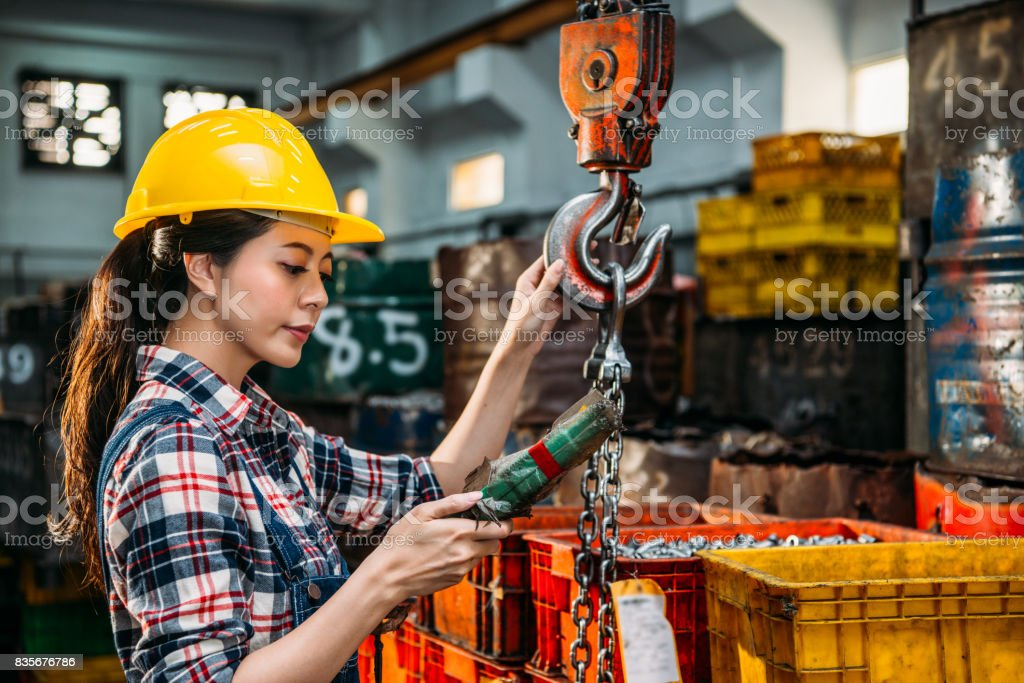 worker wearing helmet holding remote control stock photo