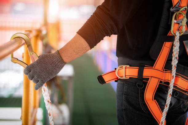Worker wearing safety harness. stock photo