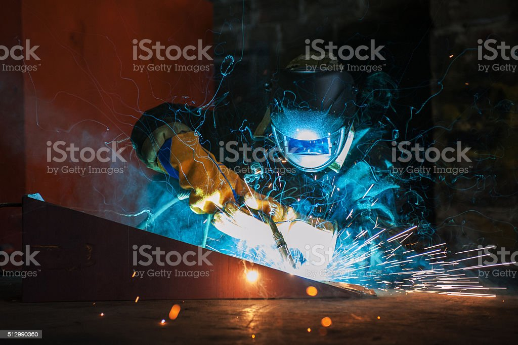 worker welding metal stock photo
