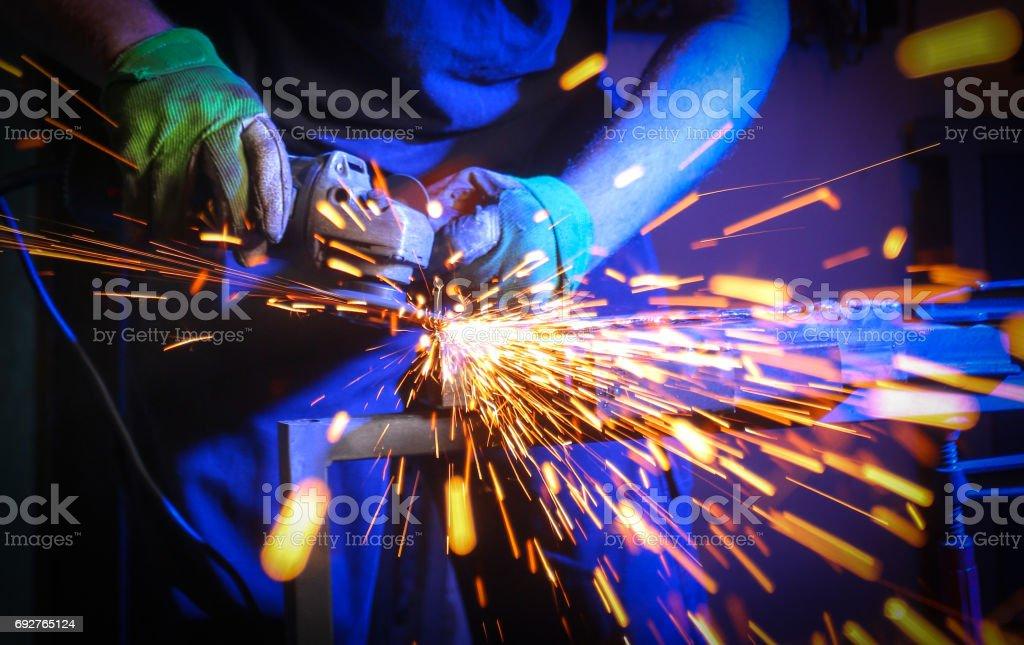 Worker welding the iron stock photo