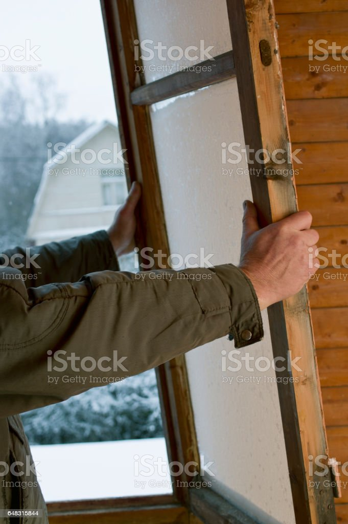Worker With An Old Window stock photo