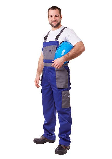 arbeiter mit blauen helm - legere arbeitskleidung stock-fotos und bilder