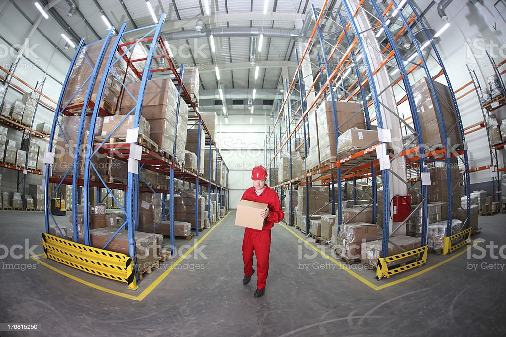 worker with box in the warehouse royalty-free stock photo