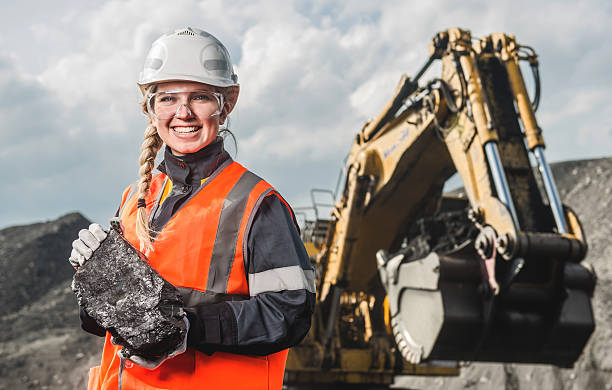 Worker with coal in the hands stock photo