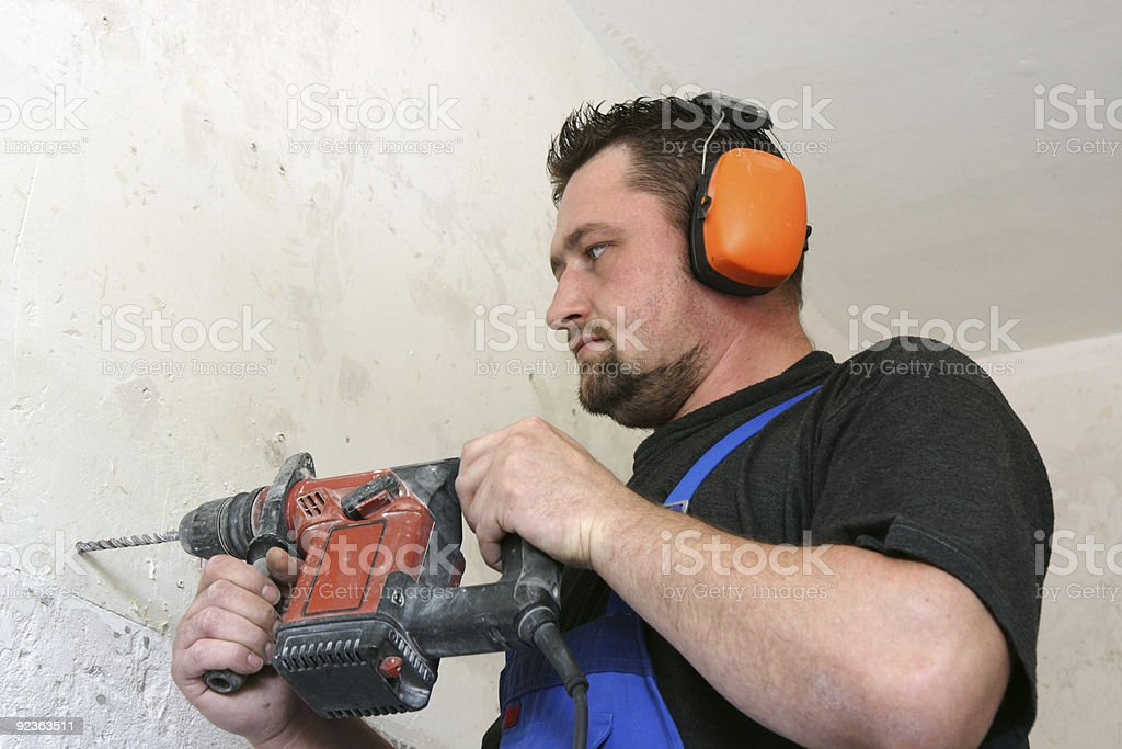 Worker with drill royalty-free stock photo