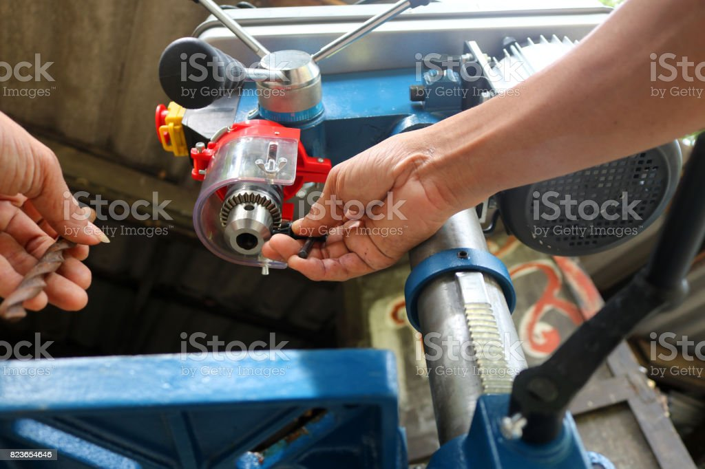 Worker with Drill presses machine for industry stock photo