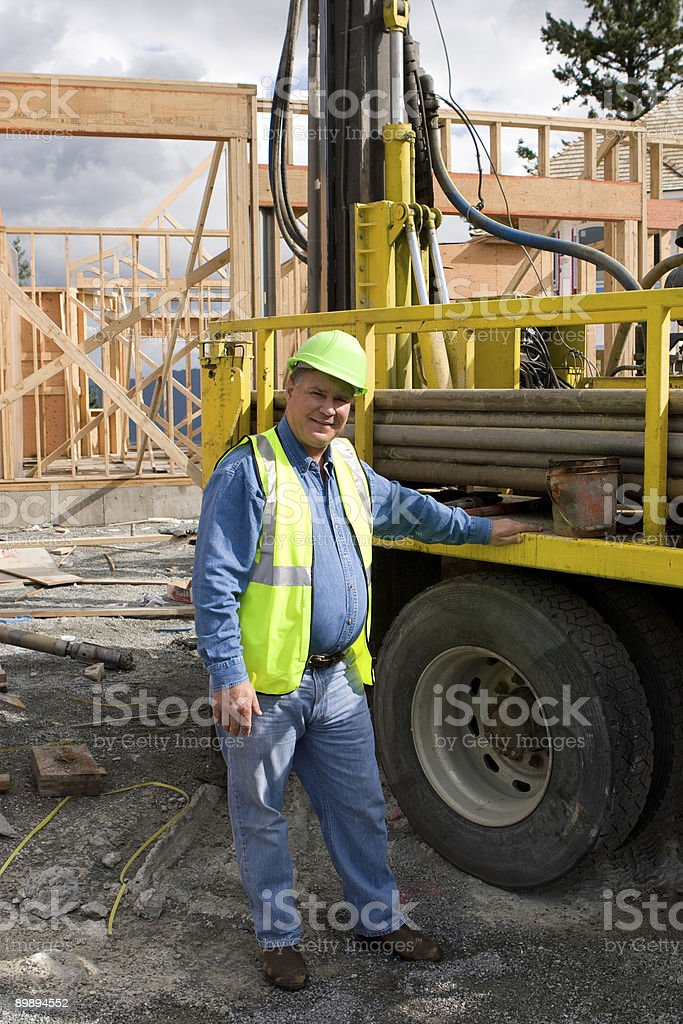 Worker with drill rig royalty-free stock photo