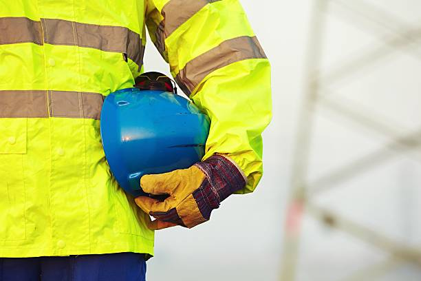 Worker with helmet stock photo