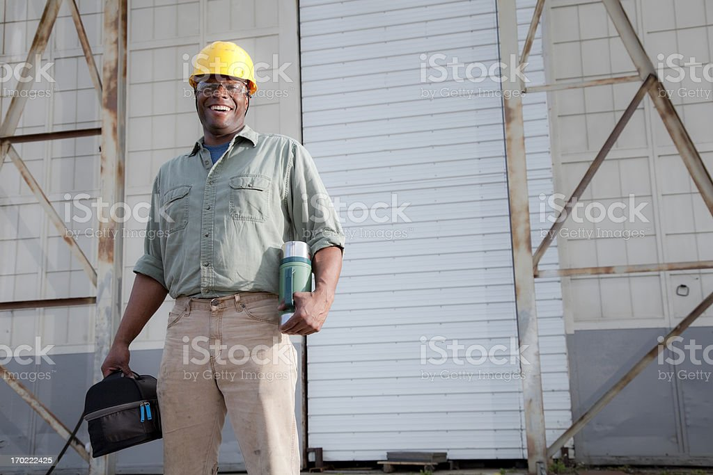Worker with lunchbox royalty-free stock photo