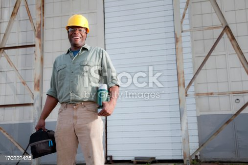 istock Worker with lunchbox 170222425