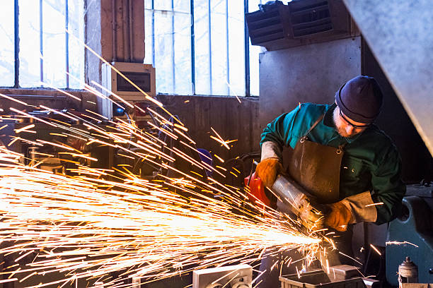 Worker with metal cutting grinder stock photo