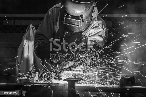 istock worker with protective mask welding metal 639849256