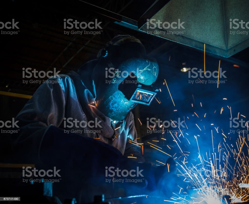 worker with protective mask welding metal royalty-free stock photo
