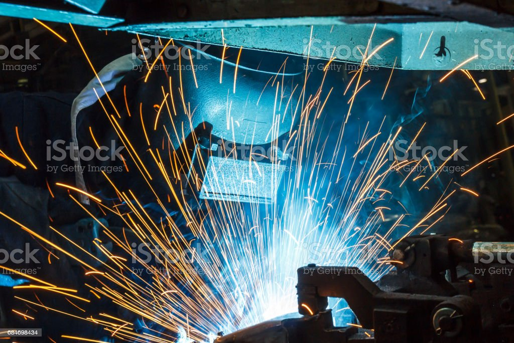 worker with protective mask welding metal stock photo