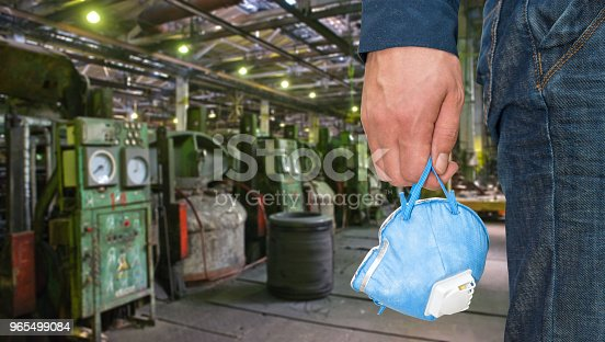 istock Worker with protective respirator 965499084