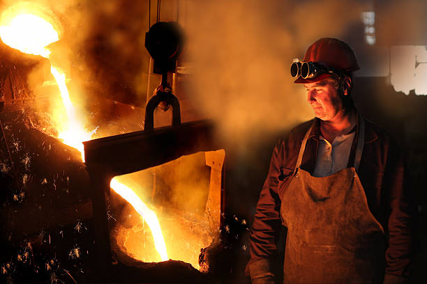 worker with safety goggles in a foundry - metallurgy stock photos and pictures