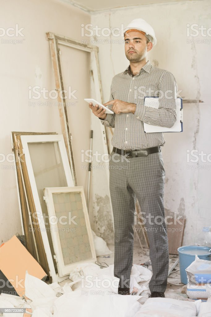 worker  with tablet in the hand - Royalty-free Adult Stock Photo