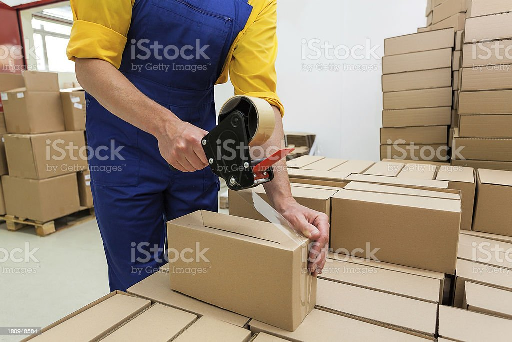 Worker with tape gun stock photo