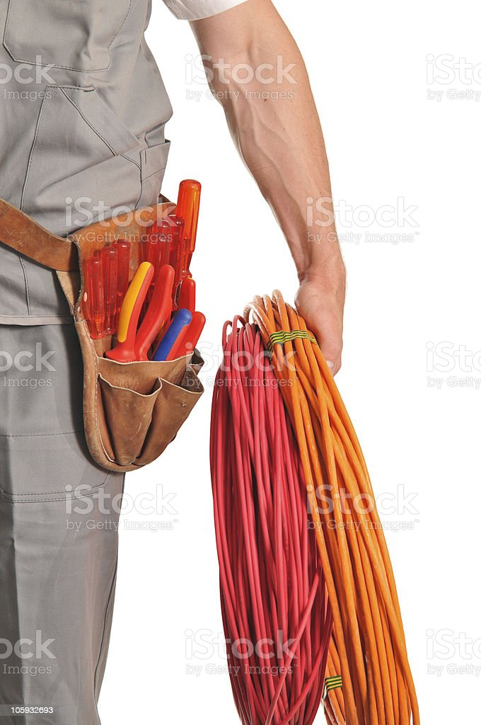Worker with tool belt and wire stock photo