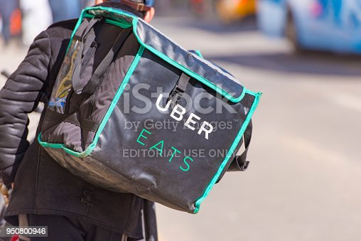 MOSCOW - APR 23: Worker with Uber Eats bicycle and a bag in a street of Moscow on April 23. 2018 in Russia