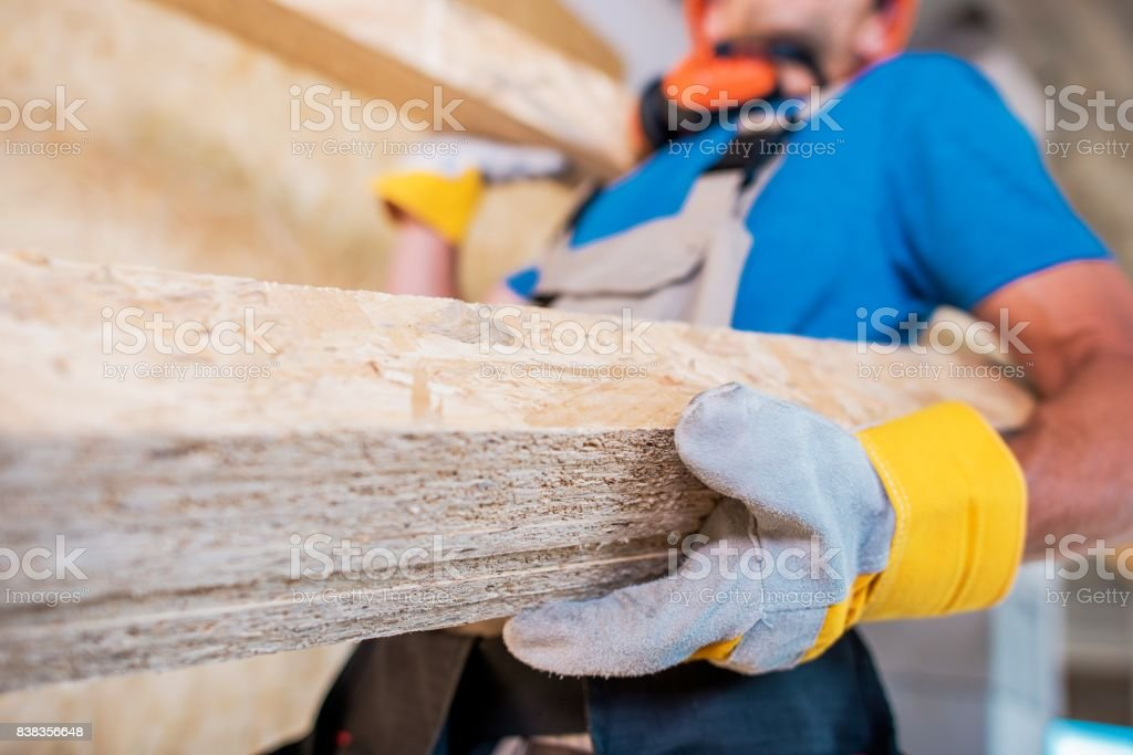 Worker with Wooden Materials stock photo