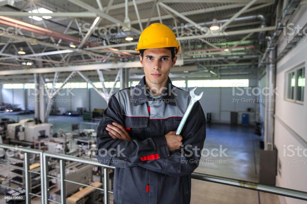 Worker with wrench at CNC factory - Zbiór zdjęć royalty-free (Brygadzista)