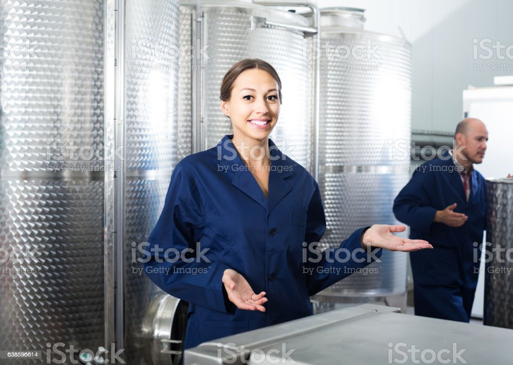 worker woman standing indoors on small wine manufacturing stock photo