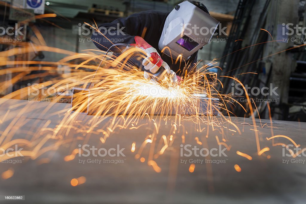 A worker working on metal sheets stock photo