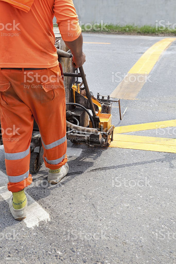 worker working on road traffic line building royalty-free stock photo