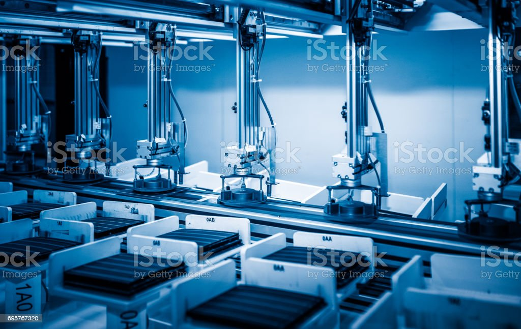 workers and machinery in a solar panel manufacturing industry factory stock photo