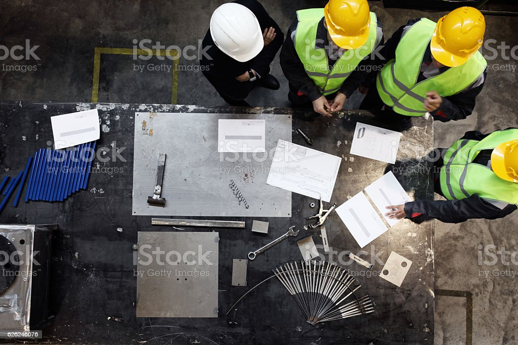 Workers and manager at factory stock photo