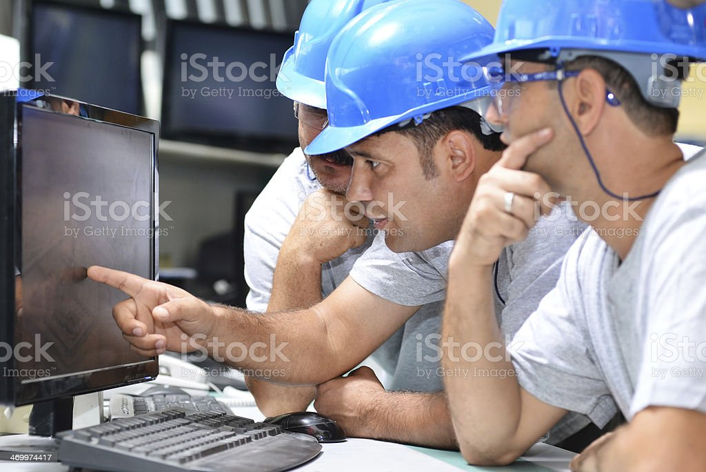 Workers are checking factory map stock photo
