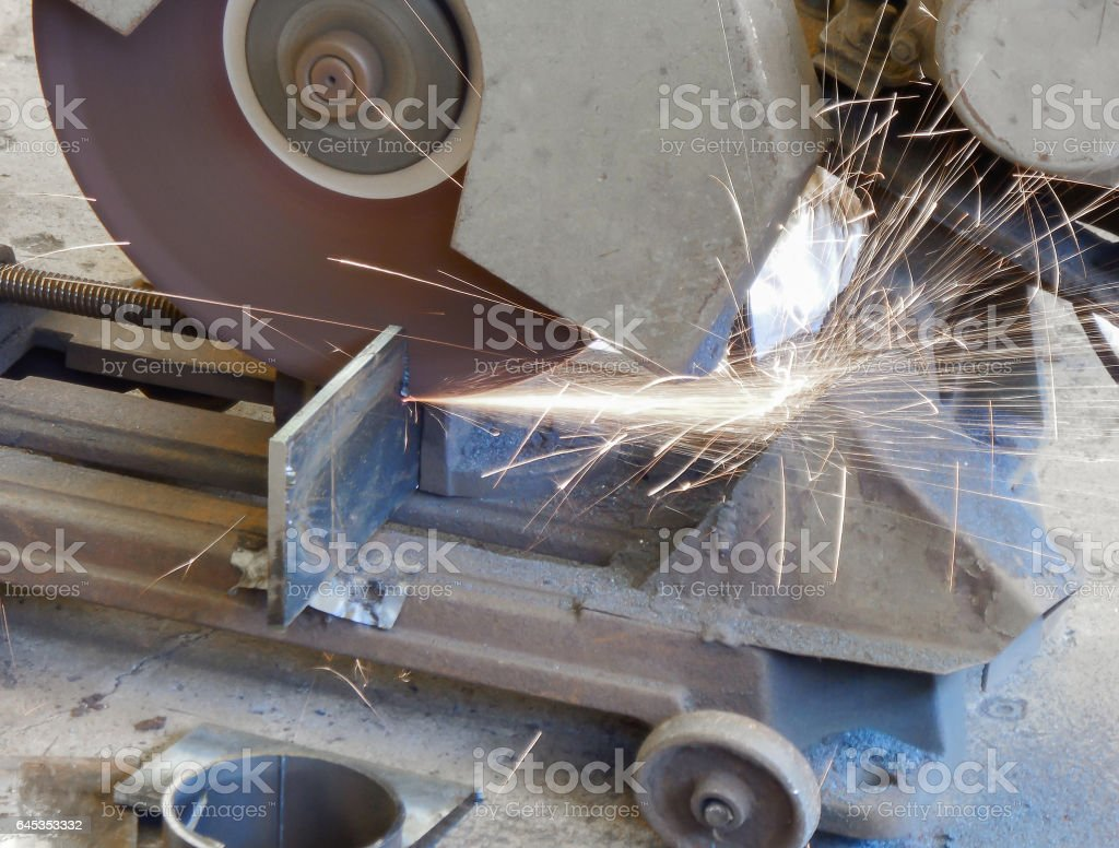 Soft focused picture of Workers are cutting steel sheet by a sparks...
