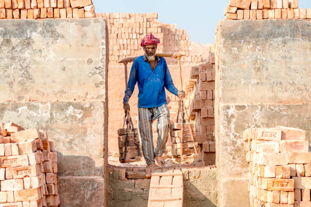 Workers are working in Brick Field stock photo