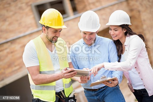 istock Workers at a construction site 473163288