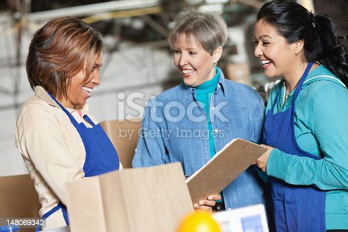 istock Workers at a plant laughing together 148069342