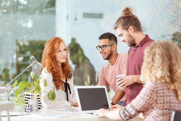 Workers at advertising agency stock photo