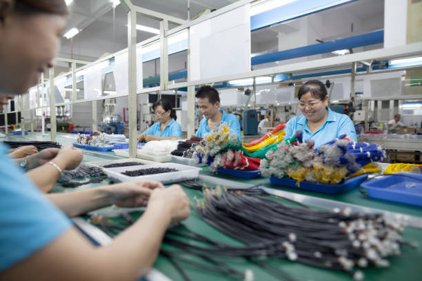 Workers at an electronics factory in Dongguan, China stock photo