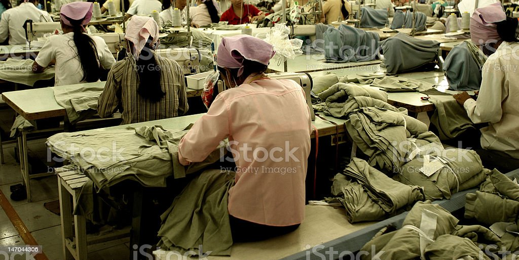 Workers at garment factory in Southeast Asia royalty-free stock photo