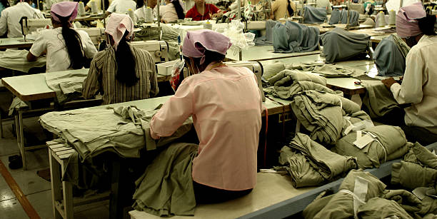 Workers at garment factory in Southeast Asia stock photo