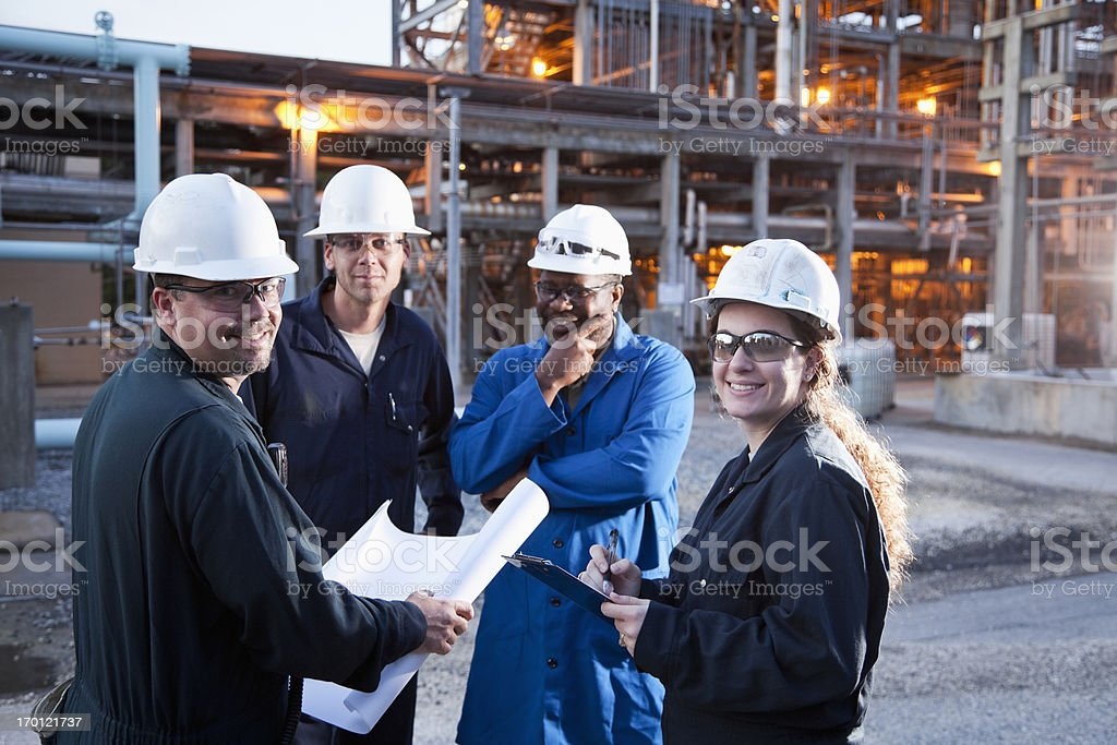 Workers at manufacturing plant royalty-free stock photo