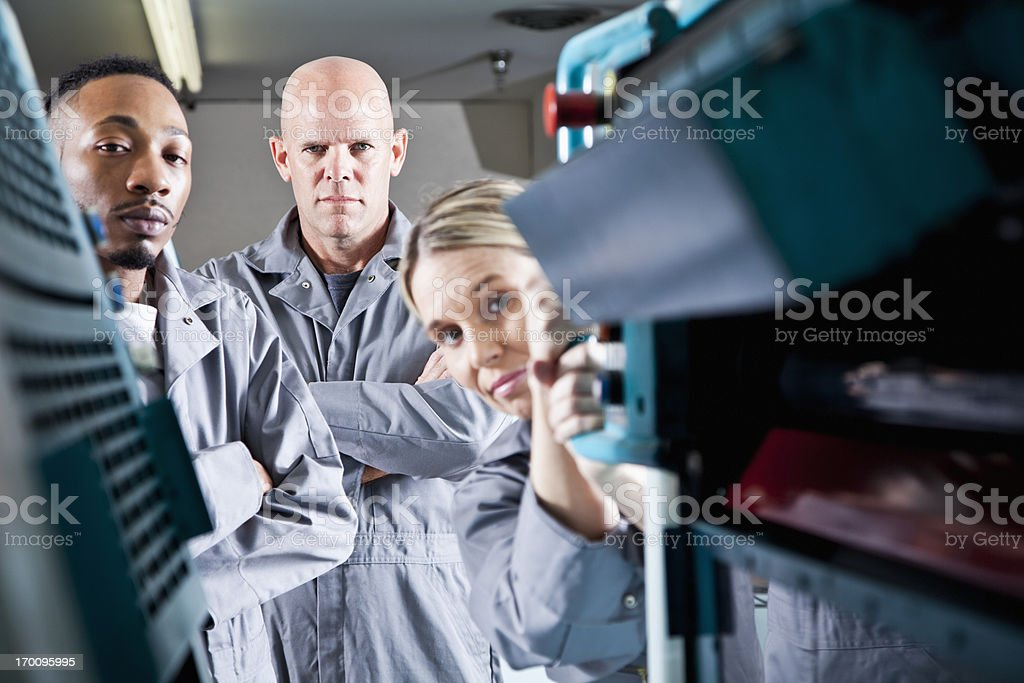 Workers at printing plant stock photo