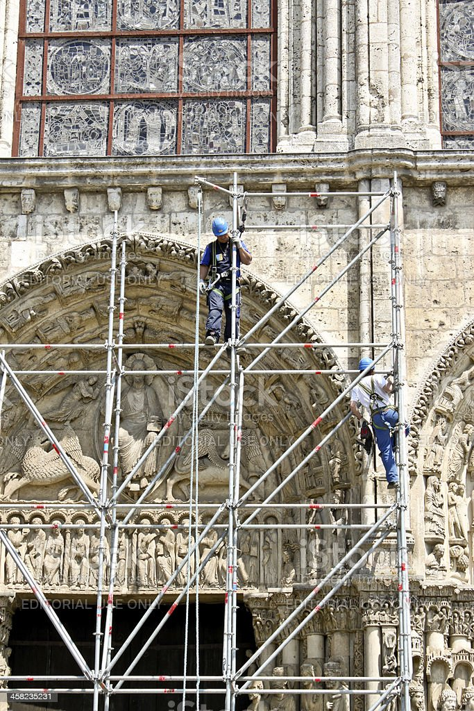 workers at reconstruction of Chartres cathedral royalty-free stock photo