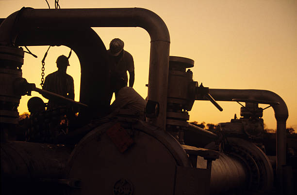 Workers at sunset stock photo